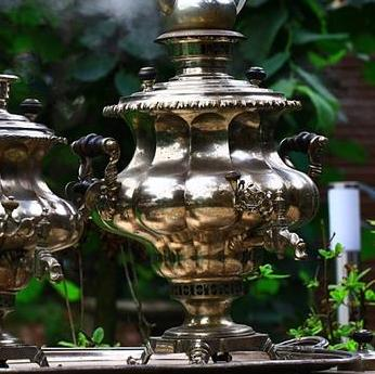 The device is a fire samovar on the wood